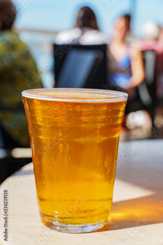 Tuinposter Bier / Cider Close up shot of a glass of cold beer