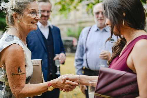 Fotografie, Obraz  Mother of the bride greeting the guests at a wedding party