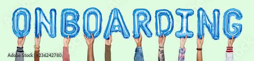 Fényképezés  Hands holding onboarding word in balloon letters