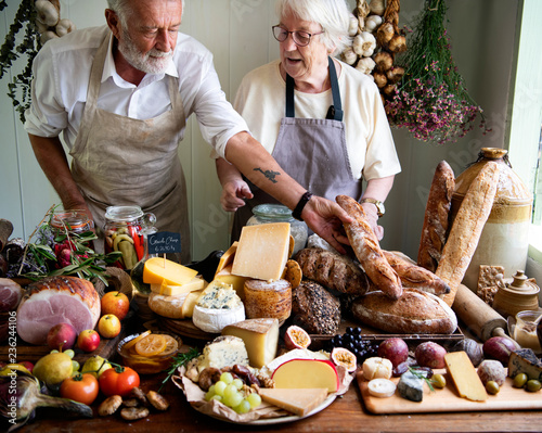 Senior couple working at a farm shop