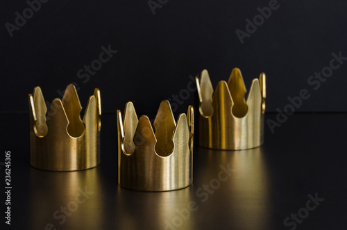 Three gold crowns, symbol of Tres Reyes Magos  ( Three Wise Men) who come bringing gifts for the kids on Epiphany or Dia de Reyes Magos Fototapet