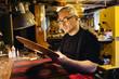 Craftsman working in guitar making workshop