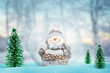 Cute snowman in magic Christmas, New Year ball. Snowflakes fall on it.