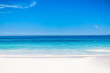 Tropical White Beach With Blue Ocean In Paradise Island