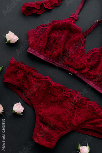 a153dd553 Red lacy lingerie womens underwear on black background. - Buy this ...