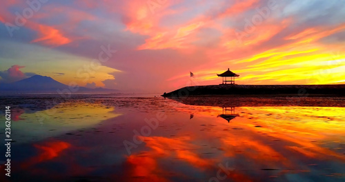 Photo sur Toile Orange eclat Asian Gazebo Silhouette During Tropical Sunrise On Ocean Point - Sanur Beach, Indonesia
