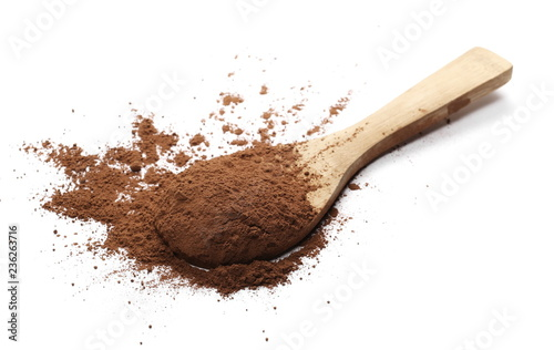 Cocoa powder pile with wooden spoon isolated on white background