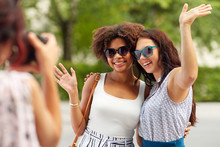 Female Friendship, Technology And People - Woman With Camera Photographing Her Friends Waving Hands In Summer