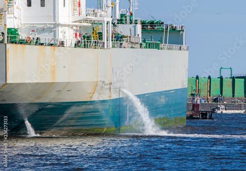 Tanker discharging ballast into the harbor Canvas Print