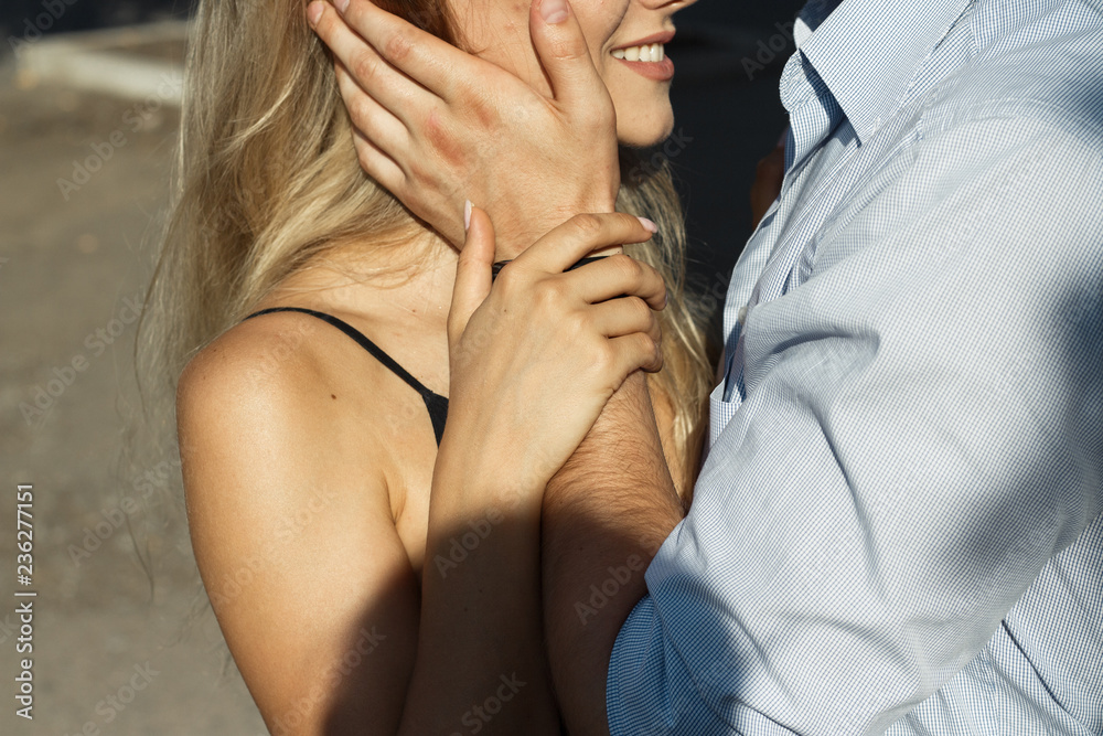 Fototapety, obrazy: happy, loving couple hugging. guy kisses girls, protection. protects