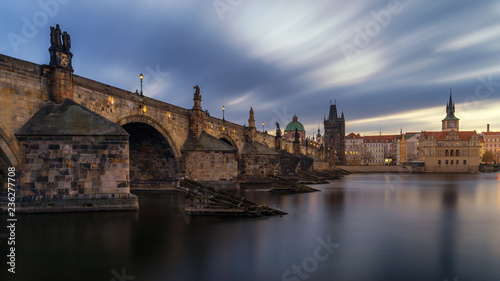 In de dag Centraal Europa Morning view of Charles Bridge in Prague, Czech Republic. The Charles Bridge is one of the most visited sights in Prague. Architecture and landmark of Prague. Long exposure photo.