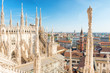 Leinwanddruck Bild - White statue on top of Duomo cathedral and view to city of Milan
