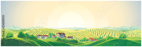 Rural panoramic landscape with a village and hills with gardens and fruit trees © Rustic