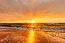 Scenic Sunset Over Sea With Setting Sun Rays Coming Through Dramatic Clouds On Orange Blue Sky Reflecting On Water Panoramic Aerial Nature Dusk Atmosphere Evening Landscape Background
