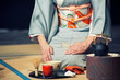 Leinwanddruck Bild - a japanese woman shows the tea ceremony during a public demonstration