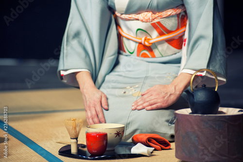 Leinwand Poster a japanese woman shows the tea ceremony during a public demonstration