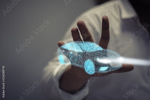 Photo businessman holding icon car / Concept of car aftermarket service