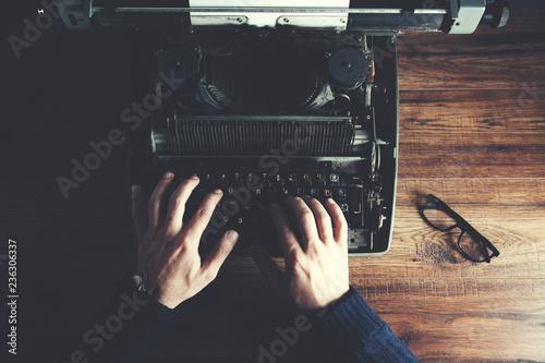 Fototapeta Typewriter with man hand