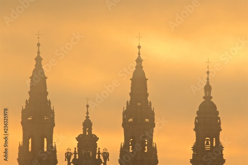 Leinwand Poster View of Santiago de Compostela Cathedral steeples at sunset in Santiago de Compo