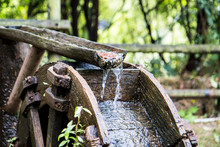 Old Wooden Waterwheel In The F...