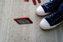 Man Legs With Falling Phone