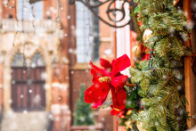 Christmas-tree Decoration In The Form Of An Artificial Red Flower On The Background Of The Ancient Architecture Of Wroclaw, Poland