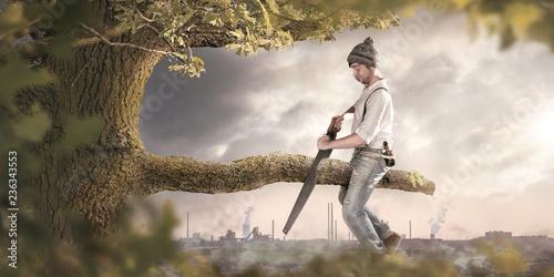 Fotografie, Obraz  Mann sägt am Ast auf dem er sitzt