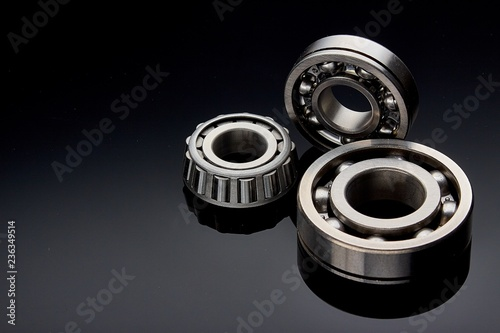 Close-up of a set of ball and roller bearings on a dark background Canvas Print