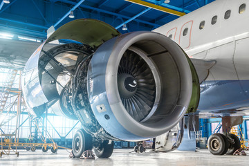 Aircraft engine jet on the wing during maintenance in the hangar.