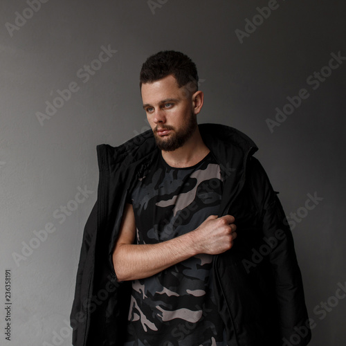 Handsome Young Man With Hairstyle And Stylish Beard In A Fashionable