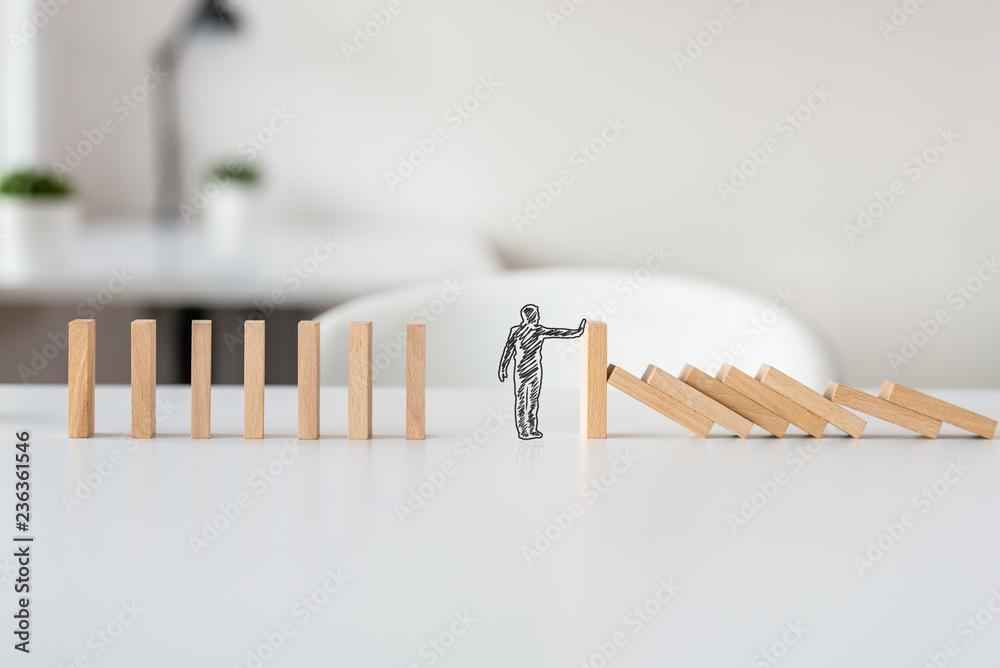 Fototapeta Hand drawn shape of businessman stopping domino effect