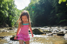Girl Walking In Creek
