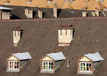 Attic Windows Of Oldtown Building In Strasbourg - France