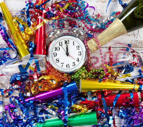 Happy New Year Celebration with clock in center of party objects on white rustic Wallpaper Mural