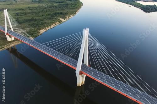 Fototapeta Beautiful bridge over the river. The bridge on the cables is roa obraz