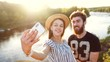 Happy young couple talking on video chat mobile phone app, taking selfie for social media. Woman and man traveling outdoor on romantic vacation, making nature landscape photo, chatting with friends.