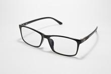 Black Eyeglasses On A White Ba...