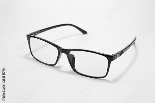 Obraz Black eyeglasses on a white background - fototapety do salonu