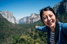 Woman Hiker Taking Selfie Poin...