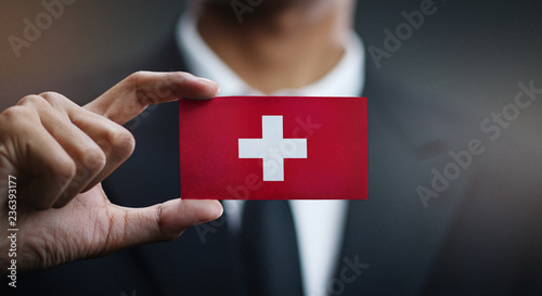 Fototapeta Businessman Holding Card of Switzerland Flag