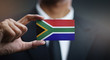 canvas print picture - Businessman Holding Card of South Africa Flag