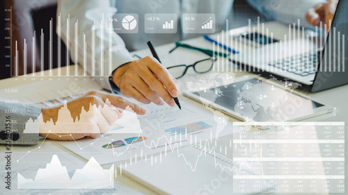 businessman investment consultant analyzing company financial report balance sheet statement working with digital graphs Canvas Print
