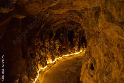 Very old tunnel through mountain rock Canvas-taulu