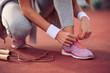 Woman tying sports shoe