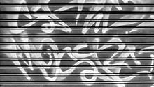 Black Garage Gate With Graffiti