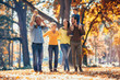 canvas print picture - Multl generation family in autumn park having fun