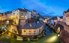 Saarburg, Germany. Cityscape With Leuk River And Old Historic Watermills At Dusk