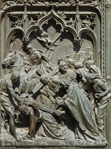 Fototapeta The death sentence and the way to the Calvary of Jesus Christ, detail of the main bronze door of the Milan Cathedral, Duomo di Santa Maria Nascente, Milan, Lombardy, Italy obraz na płótnie