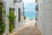 A Narrow, Quiet Stone Street I...