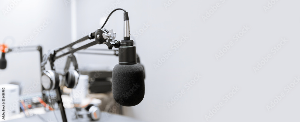 Fototapeta technology and audio equipment concept - microphone at recording studio or radio station